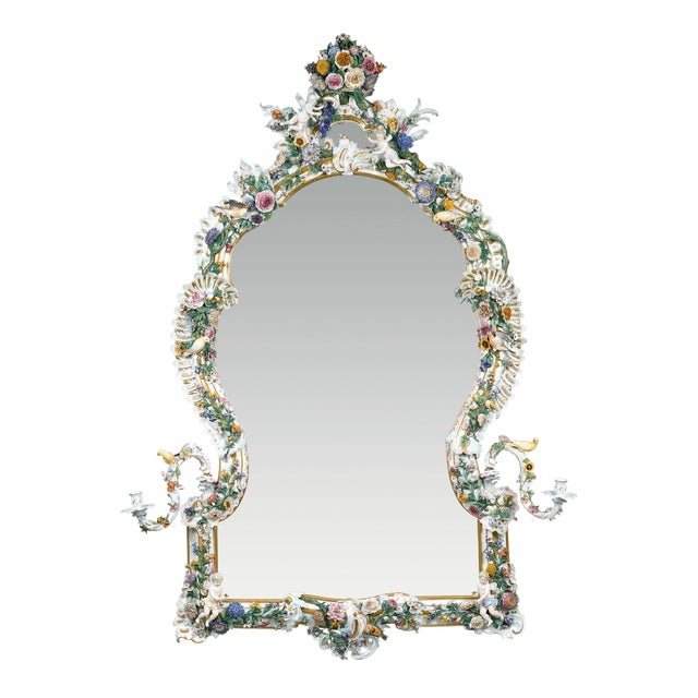 This sumptuous Meissen porcelain mirror is a work of astounding artistry and rarity that would only have been created for...
