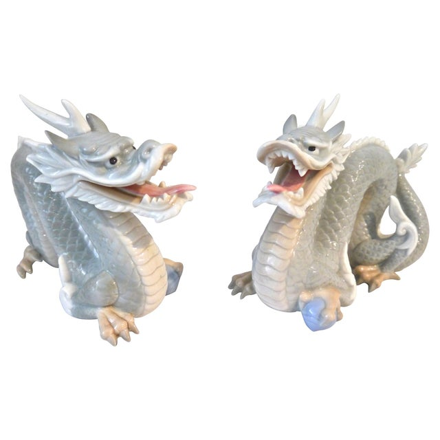 "A beautiful pair of porcelain dragon figurines that were made in Japan by Yoshimi. Each stands at 6"" tall by 8"" long. The..."