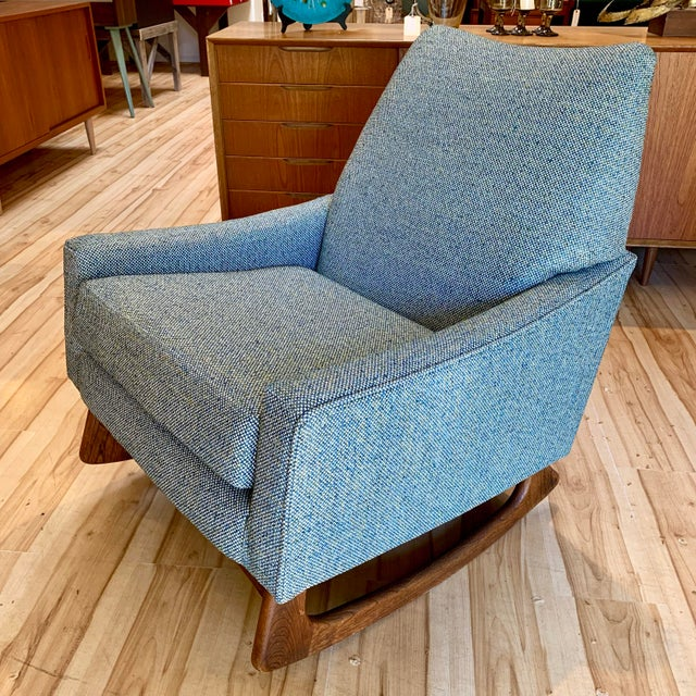 Mid-century modern upholstered rocking chair with walnut runners designed by Adrian Pearsall for Craft Associates. The...