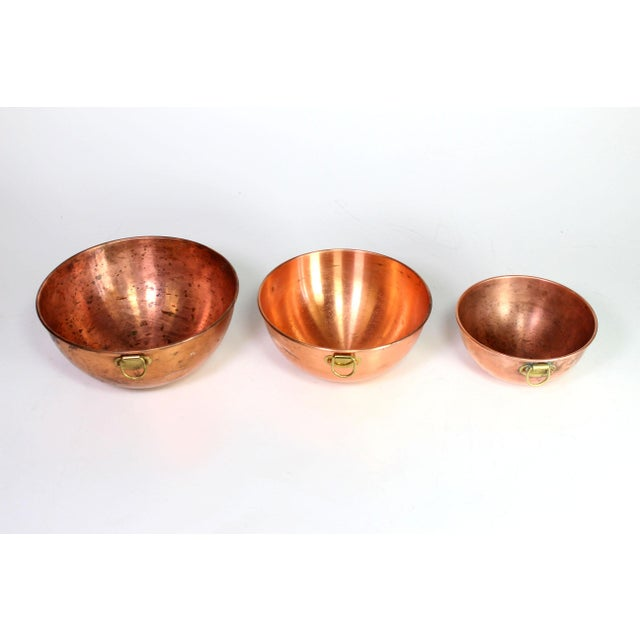 This set of 3 1970's copper nesting bowls are complete half spheres which means they are round all the way through, the...