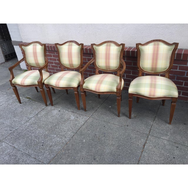 Four Carved Neoclassical Dining Chairs with silk upholstery, 2 arms and 2 sides. These are in excellent condition, the...