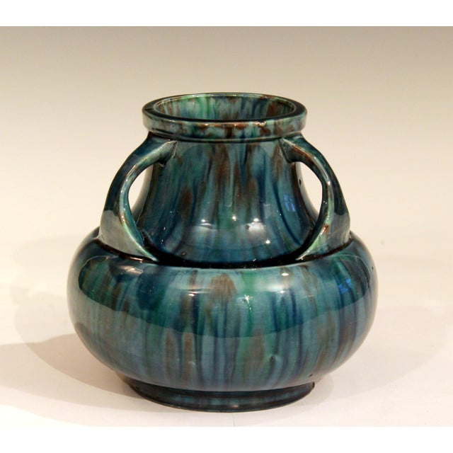 Awaji Pottery vase in Art Deco form with three handles curled over the wide, recessed shoulder and striking blue flambé...
