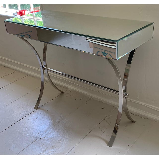 A versatile small console, it can easily double as a desk or vanity. The mirror surfaces are all beveled and in immaculate...