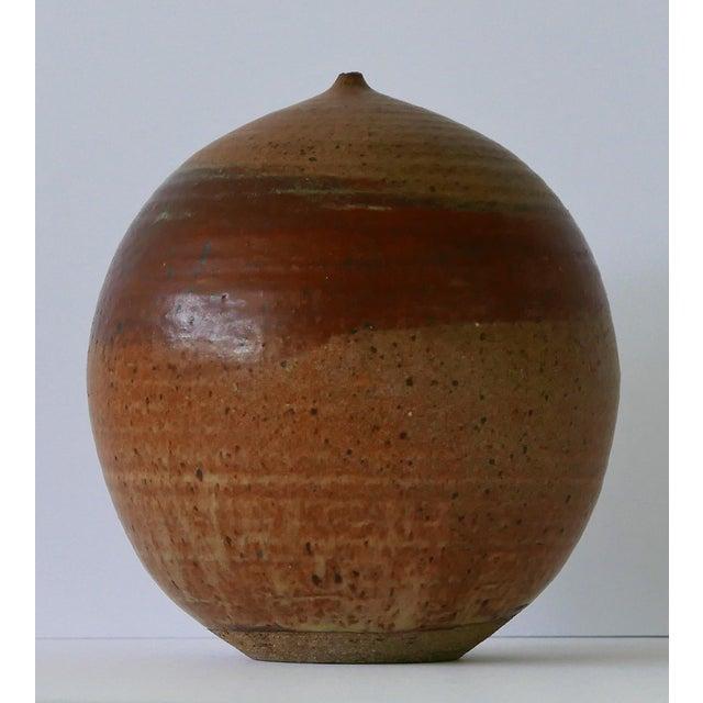 Excellent condition vase in pleasing neutral color tones. Its large bulbous shape with small short neck is unique. Goes...