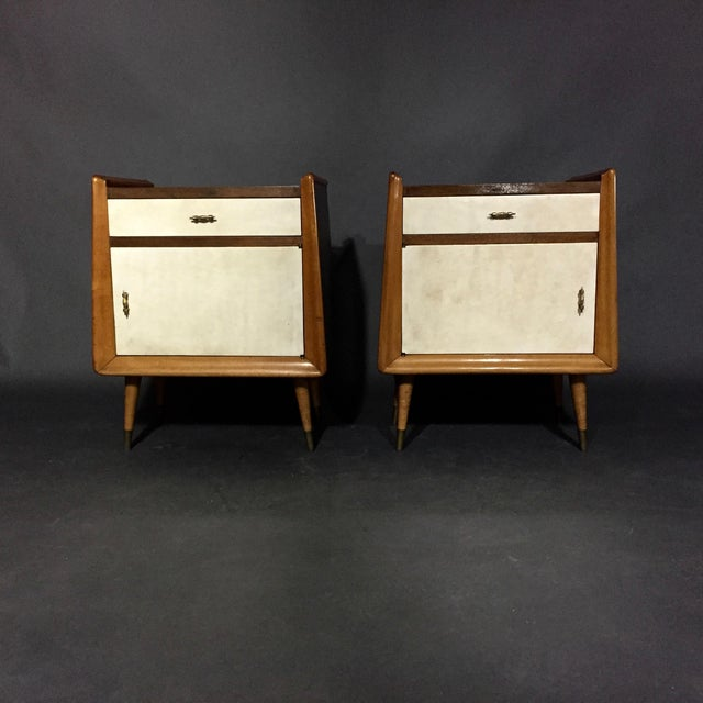 A sweet pair of nightstands with a U-shape case framed in lacquered maple. Top drawer and bottom case faced in a classic...