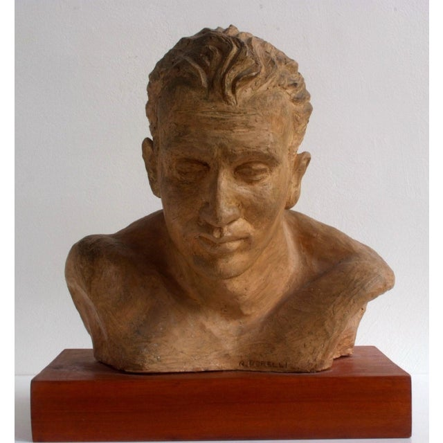 Beautiful signed clay sculpture by A. Perelli. 1950s portrait of an athlete on a wood base. The work is in mint condition...