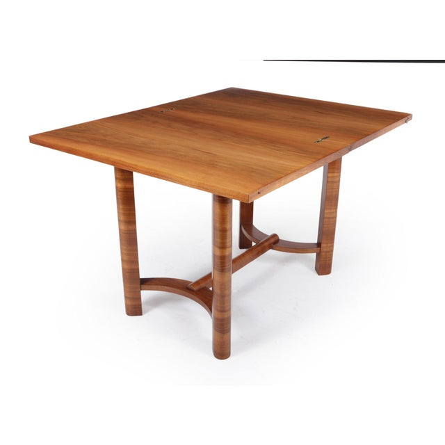 A walnut tea table or games table with a turning flip over top to reveal storage underneath fully restored and hand...