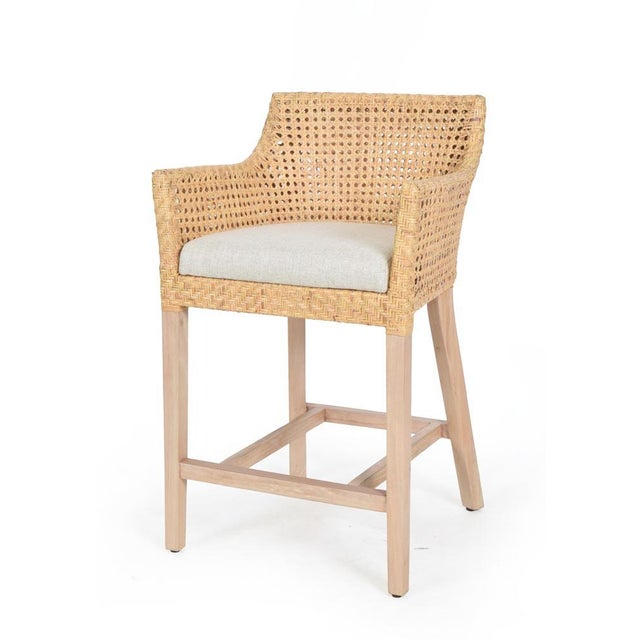 Blora Counter Chair. Mahogany Wood Frame, Woven Rattan Peel Color - Natural; Cushion Color - Cream. Chair weight limit 225.