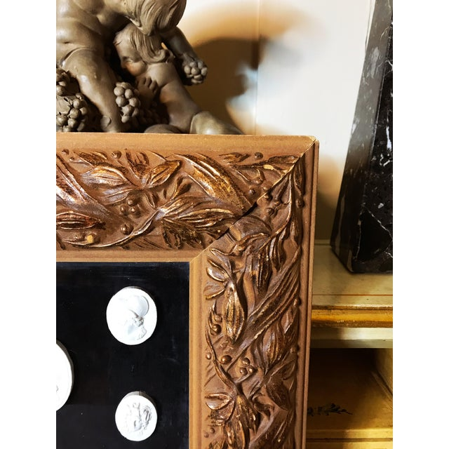 Here we have a lovely arrangement of grand Tour Italian Plaster Cameos, on the black velvet background with beautiful...