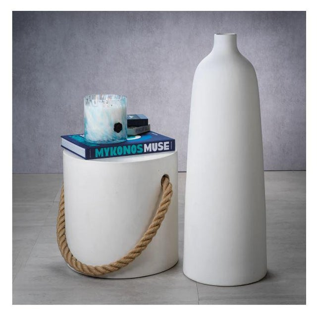 The White Concrete Round Stool A perfect little pull up stool for sitting, as a drinks table, or a place to prop a book....