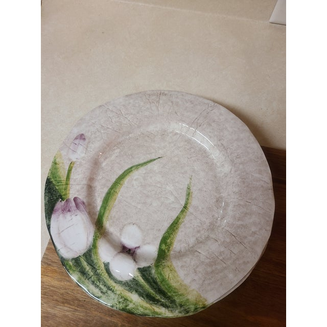This set of 4 large dinner plates have a beautiful texture and glaze that enhances the hand-painted tulip design. Called...