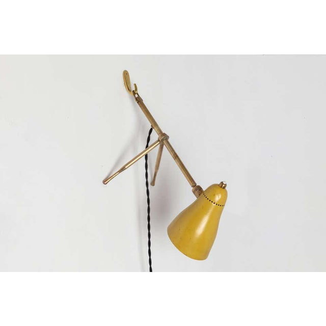 """1950s Giuseppe Ostuni """"Ochetta"""" yellow wall or table lamp for O-Luce. An extremely rare and surprisingly utilitarian lamp..."""