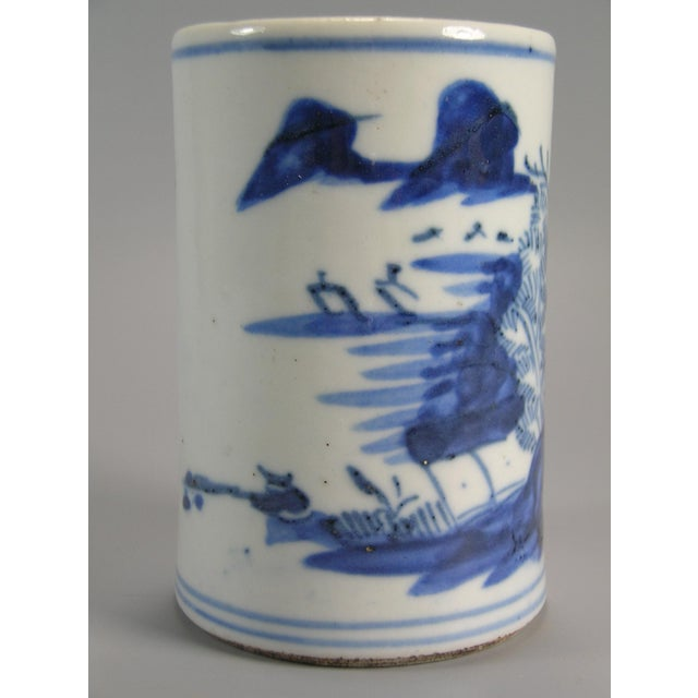 Up for sale is a small antique blue and white porcelain brush pot (brush holder, Bitong) decorated with freehand brushwork...