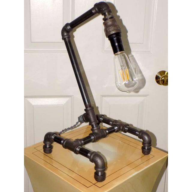 A unique, hand-crafted, black pipe desk light. A fantastic, industrial/ steampunk decor made of all new materials. Black...