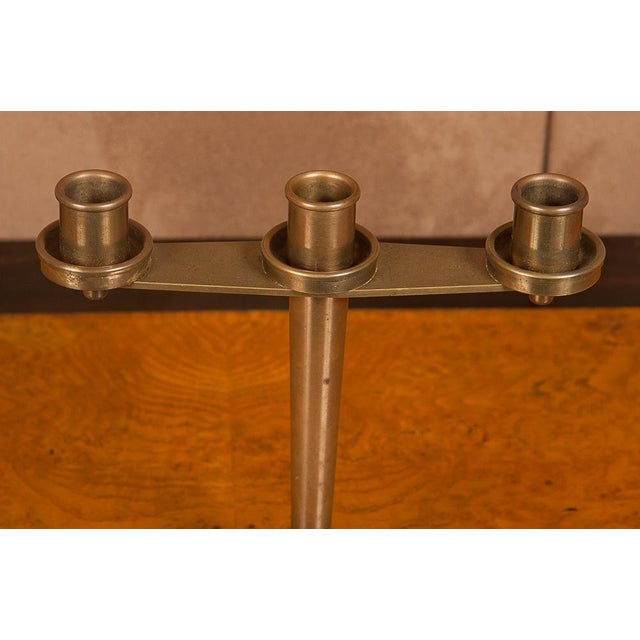 A pair of signed Art Deco French bronze Tiffany candelabra. Model 511 signed Tiffany & Co. on the bottom.