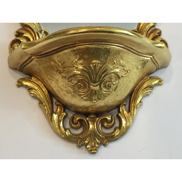 Beautiful classic mid century Syroco gilded mirror and wall bracket/shelf that is perfect for a collectible you want to...