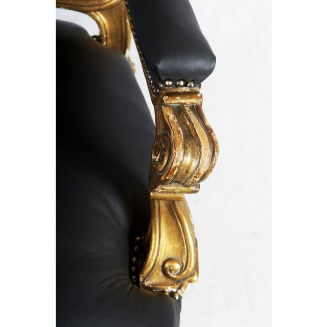 - Rococo style black leather upholstered open armchair on cabriole legs with balls on the ends, gold plated - Made in...