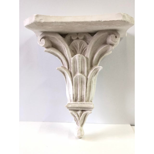 20th Century white wall shelf over a neoclassical acanthus carved plaster bracket created in the style of Serge Roche.