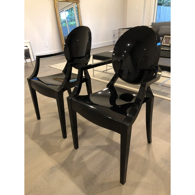 A pair of Kartell glossy black chairs in perfect condition.