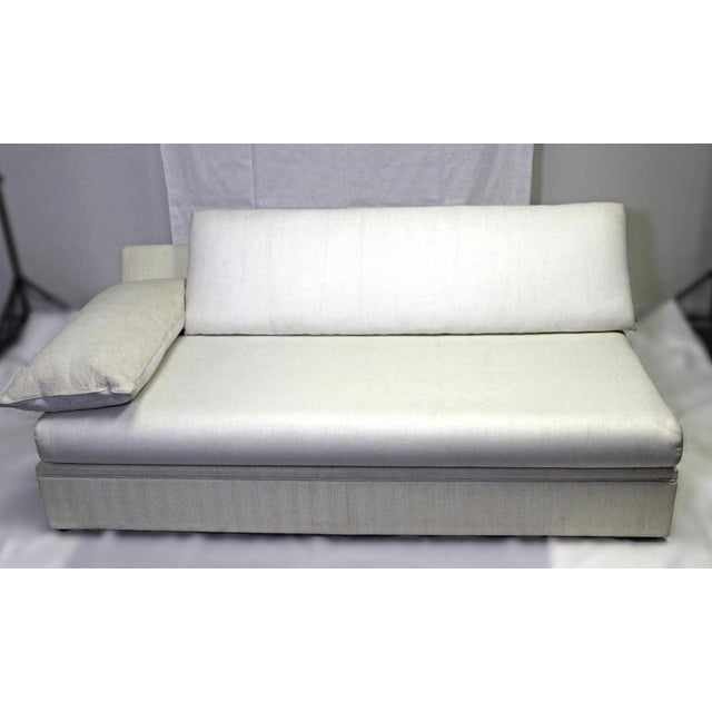 On offer on this occasion is a very fine quality modern designer armless sofa, dressed in a peerless, cream colored...