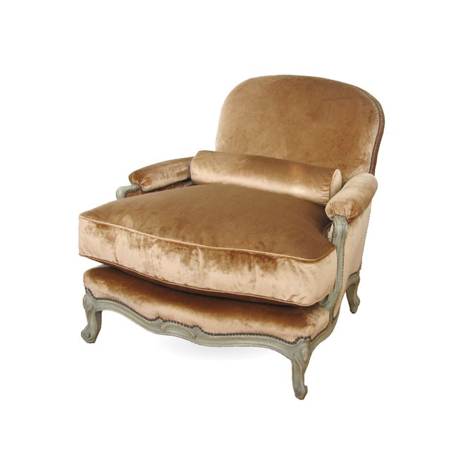 "The ""Barroux"" model, a large Louis XV style bergere with sprung seat and sprung back with down cushion, bolster and..."