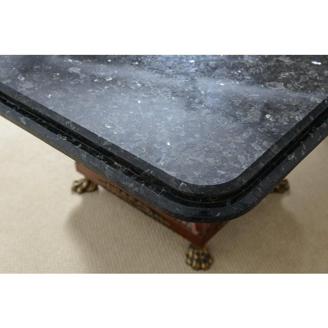 Fabulous Hollywood Regency Table on bases with Bronze Claw feet and Bronze accents. Beautiful Black Granite Ogee Edge top....
