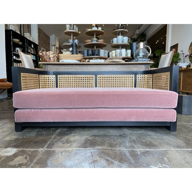 Vintage caned Back Sofa reupholstered in a mauve mohair fabric