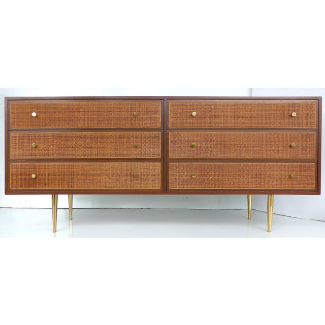 A striking Mid-century Modern dresser with woven cane drawer fronts by Harvey Probber. The dresser has six drawers with...