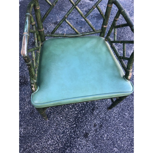 Incredible antique hand painted malachite arm chair with gilt touches.A beautiful worn patina of a well loved chair. It...