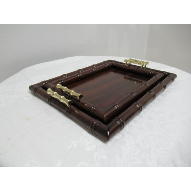 This is pair of vintage Bombay Company stacking trays from the 1990s. The pieces feature faux bamboo construction.