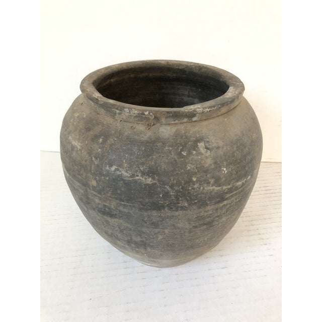 Antique hand-crafted matte gray clay pot with hand-thrown details, and time-worn patina.
