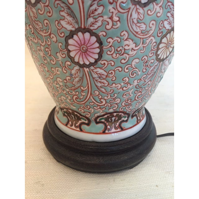 Gorgeous Asian style lamp with pink and pale yellow flowers and terracotta colored scrolls on ming green background. Wood...