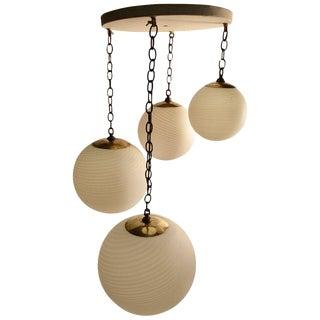 Four-Globe, Cascading Form Cahndelier For Sale