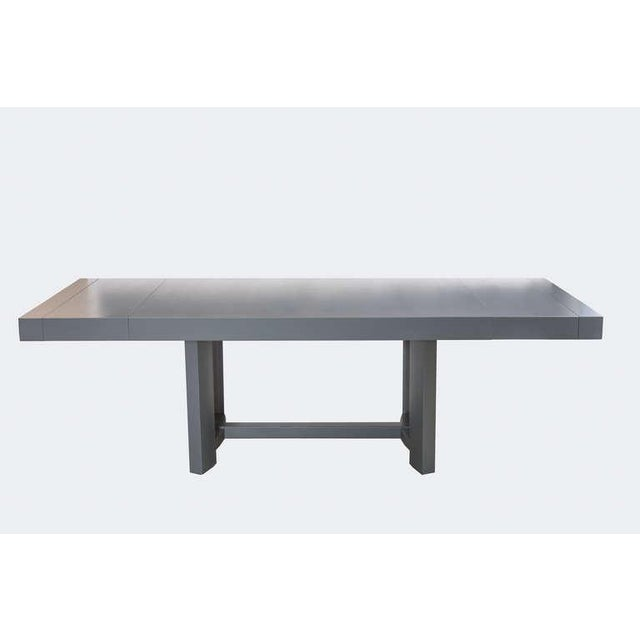 """Unique dining table by T.H. Robsjohn-Gibbings for Widdicomb. Refinished in dark grey matte lacquer. With two matching 15""""..."""