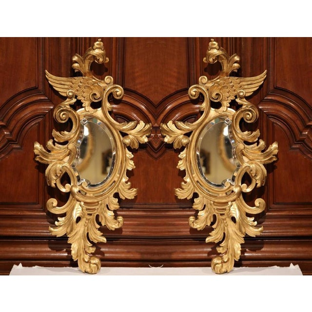 This beautiful pair of antique wall hanging mirrors were created in France, circa 1860. Both mirrors are set inside a...