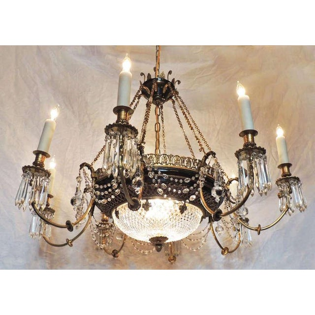 This chandelier was made in France in the late-19th century and was created in a Russian Empire style. The crystal bowl is...