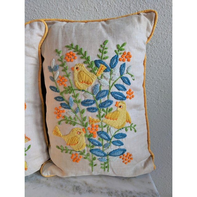 This is an amazing pair of 1960s mid-century needlepoint Embroidered throw pillows with gorgeous and vivid hand...