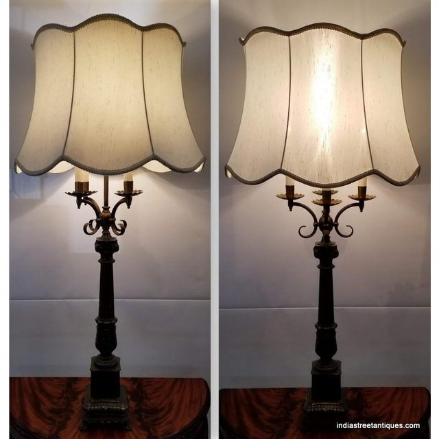 Pair tall metal table lamps in the French Empire candelabra style date to 1920-1926, a period of revival in this style of...