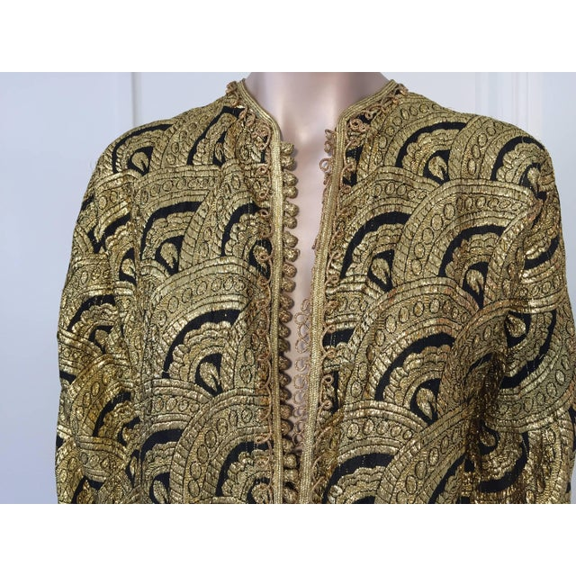 Elegant Moroccan caftan gold and black Art Deco style brocade silk fabric, circa 1960s. This kaftan is embroidered and...