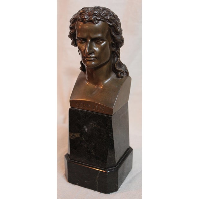 Here is an early 20th-century bronze bust of Schiller. This piece is mounted on a marble base.