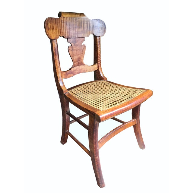 A beautiful 19th century early American Tiger Maple side chair with caned seat. Highly figured tiger maple wood with...