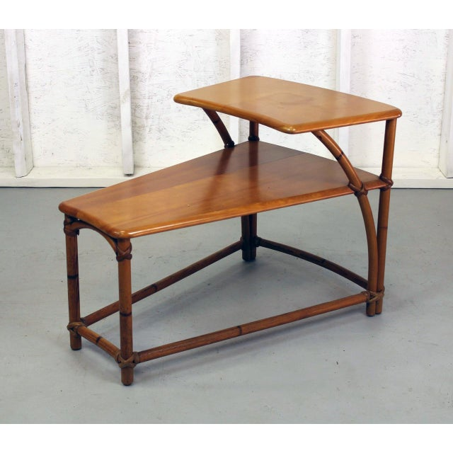 Two tiered table in very good condition. Heywood-Wakefield from the 1950s. Solid Birchtop and bottom shelf. Rattan frame....