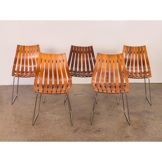 Set of Five Hans Brattrud Dining Chairs with the low-back design. Iconic Norwegian Mid-Century design. Striking slatted...