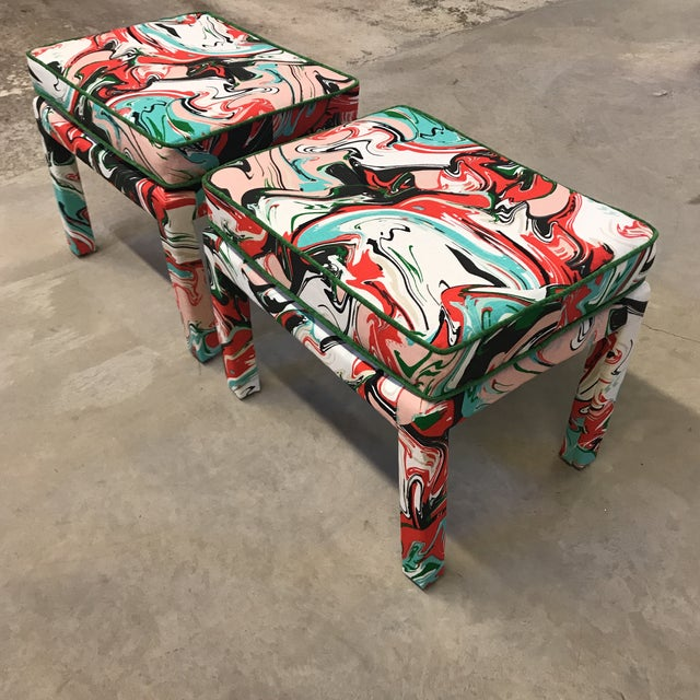 Pair of vintage benches recently reupholstered (and beautifully, I might add) in Kate Spade's marble swirl fabric in...
