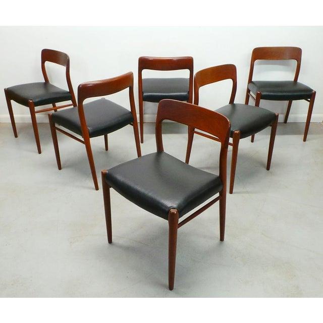 Set of 6 reupholstered black leatherette mid century Danish modern teak authentic J.L. Moller model 75 black dining...