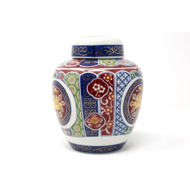 A vintage Imari Imperial porcelain ginger jar with a transfered floral and geometric pattern design, in red,blue, green...