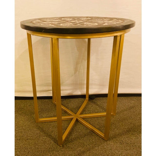 Modern Moroccan End or Side Table This chic round shaped end or side table is handmade of resin and features a beautiful...