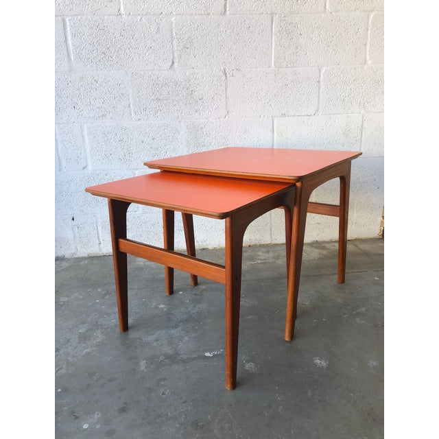 Vintage Mid-Century Danish Modern Nesting Tables with laminated Tops. Feature laminate tops in a beautiful burnt orange...