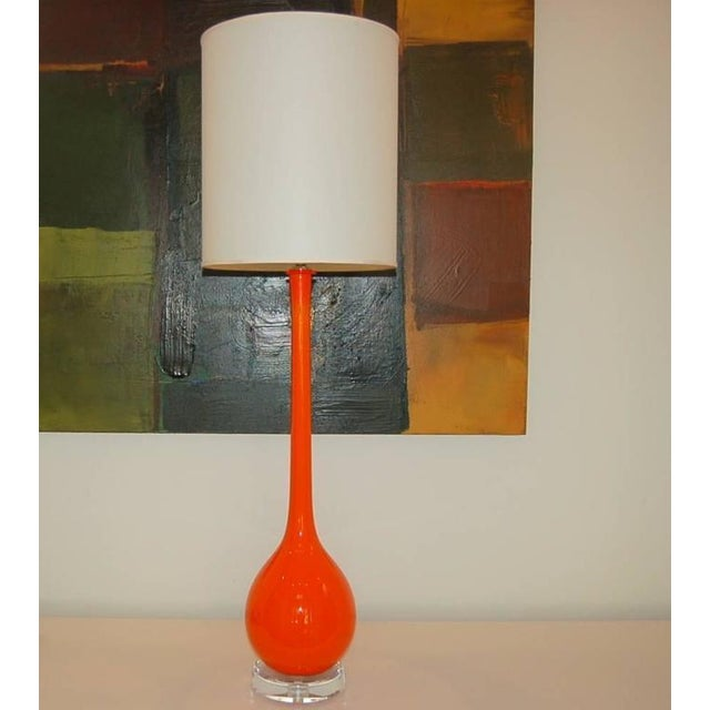 Vintage Venetian long-necked glass table lamps imported in the 1960's. A layer of white cased glass is surrounded by a...