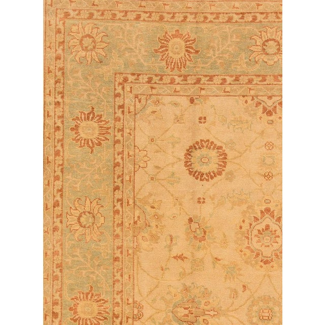 21st Century Hand-knotted Turkish Oushak rug with a floral motif. This piece has great quality and a beautiful design....